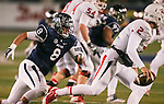 Nevada's Ian Seau (8) pursues Fresno State quarterback Brian Burrell, (2) during the second half of an NCAA college football game in Reno, Nev., on Saturday, Nov. 22, 2014. Fresno State defeated Nevada 40-20. (AP Photo/Cathleen Allison)