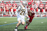 Towson, MD - March 25, 2017: Towson Tigers Mike Lynch (27) holds off a Denver Pioneers defender during game between Towson and Denver at  Minnegan Field at Johnny Unitas Stadium  in Towson, MD. March 25, 2017.  (Photo by Elliott Brown/Media Images International)