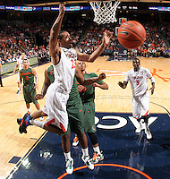 CHARLOTTESVILLE, VA- JANUARY 7: Mike Scott #23 of the Virginia Cavaliers goes after a loose ball during the game against the Miami Hurricanes on January 7, 2012 at the John Paul Jones Arena in Charlottesville, Virginia. Virginia defeated Miami 52-51. (Photo by Andrew Shurtleff/Getty Images) *** Local Caption ***
