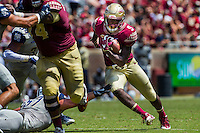 TALLAHASSEE, FLA 9/10/16-Florida State's Jacques Patrick does not let a hand from  Charleston Southern's Nick Sands stop him during a second quarter run Saturday at Doak Campbell Stadium in Tallahassee. <br /> COLIN HACKLEY PHOTO