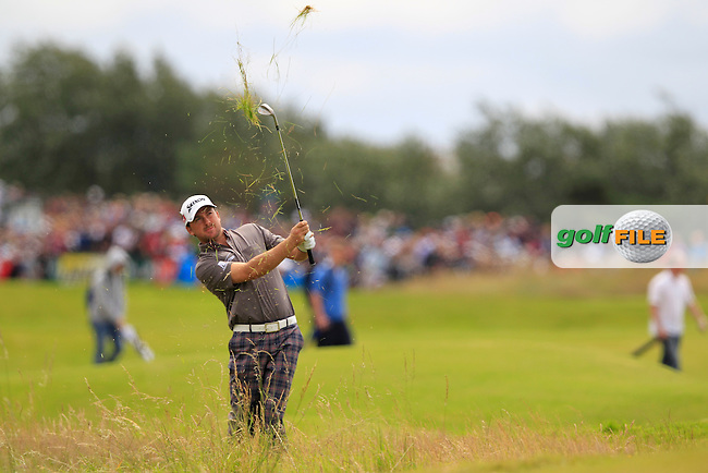 Graeme McDowell (NIR) plays his 2nd shot from the rough on the 14th hole during Thursday's Round 1 of the 141st Open Championship at Royal Lytham & St.Annes, England 19th July 2012 (Photo Eoin Clarke/www.golffile.ie)