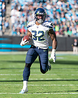 CHARLOTTE, NC - DECEMBER 15: Chris Carson #32 of the Seattle Seahawks runs with the ball during a game between Seattle Seahawks and Carolina Panthers at Bank of America Stadium on December 15, 2019 in Charlotte, North Carolina.