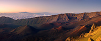 Golden glow of sunrise enhances the beauty of the Haleakala Crater on Maui in Hawaii
