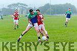 Daingean Uí Chúis Breandan Ó Céilleachair and Rathmore Mark Reen in an action during the County League match at Pairc an Aghasaigh, Dingle, on Saturday evening.