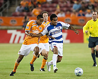 Houston Dynamo midfielder Ricardo Clark (13) and FC Dallas midfielder David Ferreira (10) fight for control of the ball.  Houston Dynamo defeated FC Dallas 1-0 at Robertson Stadium in Houston, TX on May 9, 2009