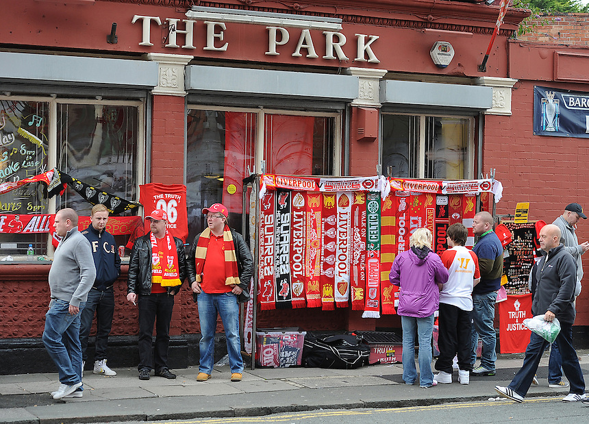 Streetsellers ply their wares outside Anfield, home of Liverpool FC..Football - Barclays Premiership - Liverpool v Manchester United - Sunday 23rd September 2012 - Anfield - Liverpool..