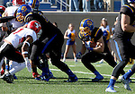 BROOKINGS, SD - OCTOBER 22:  Brady Mengarelli #44 from South Dakota State University looks for the opening to the end zone as Eric Thompson #1 from Youngstown State defends in the first half of their game Saturday afternoon at Dana J. Dykhouse Stadium in Brookings. (Photo by Dave Eggen/Inertia)