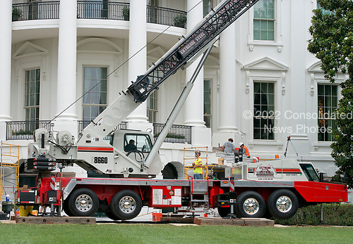 Construction cranes on the South Lawn of the White House looking towards the South Portico in Washington, DC is undergoing renovations while United States President Donald J. Trump is vacationing in Bedminster, New Jersey on Friday, August 11, 2017.<br /> Credit: Ron Sachs / CNP
