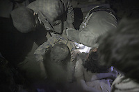 July 15, 2015 - Sa'dah, Yemen: The younger brother of Bashar Al Asadi, 14 years-old (not pictured), is rescued from the rubble of a house building after it was hit by a fighter jet from the Saudi-led coalition in the northern city of Sa'dah, the stronghold of the Houthi movement in Yemen. The family of Bashar was buried under the rubble during the attack. Two members of his family, the mother (not pictured) and his brother died from their injuries, while his sister (not pictured) survived. (Photo/Narciso Contreras)