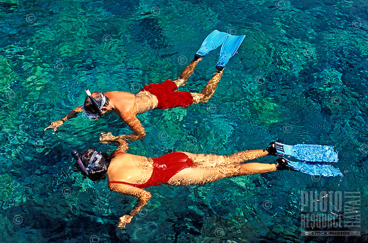 A couple enjoying the snorkeling near Captain Cook Monument , Kealakekua Bay on the Big Island of Hawaii.