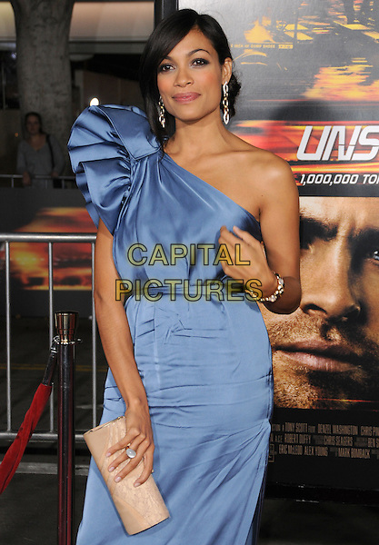 "ROSARIO DAWSON.attends the Twentieth Century Fox's L.A. Premiere of ""Unstoppable"" held at Regency Village Theater in Westwood, California, USA, October 26th 2010..half length dress blue one shoulder silk satin clutch bag beige hand bracelet nude .CAP/RKE/DVS.©DVS/RockinExposures/Capital Pictures."