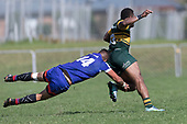 Whaiora Rangiwai gets airborne as he attempts to tackle Peni Buakula. Counties Manukau Premier Counties Power Game of the Week Club Rugby Round 4 game between Pukekohe and Ardmore Marist, played at Colin Lawrie Fields Pukekohe on Friday March 30th 2018.<br /> Ardmore Marist won the game 27 - 21 after leading 13 - 11 at halftime.<br /> Pukekohe Mitre 10 Mega 21 -Trent White, Samu Pailegutu tries, Sione Fifita conversion, Sione Fifita 2, Vilitati Sabani penalties. Ardmore Marist South Auckland Motors 27 - Katetistoti Nginingini, Karl Ropati, Alefosio Tapili tries, Latiume Fosita 3 conversions, Latiume Fosita 2 penalties. <br /> Photo by Richard Spranger.