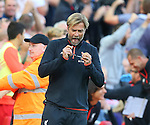 Jurgen Klopp manager of Liverpool collects his glasses that fell off his face while celebrating the second goal during the Premier League match at Anfield Stadium, Liverpool. Picture date: September 10th, 2016. Pic Simon Bellis/Sportimage