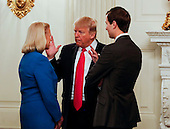 United States President Donald speaks with Ginni Rometty, CEO of IBM (L), and Senior Adviser Jared Kushner (R) before a strategy and policy forum in the State Dining Room of the White House on February 3, 2017.<br /> Credit: Aude Guerrucci / Pool via CNP