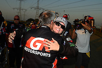 Jul. 1, 2012; Joliet, IL, USA: NHRA  pro stock driver Erica Enders celebrates with her crew after winning her first Wally at the Route 66 Nationals at Route 66 Raceway. Mandatory Credit: Mark J. Rebilas-