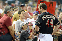 Arizona Diamondbacks first baseman Paul Goldschmidt (44) talks to fans before a game against the Washington Nationals at Chase Field on September 28, 2013 in Phoenix, Arizona.  Washington defeated Arizona 2-0.  (Mike Janes/Four Seam Images)