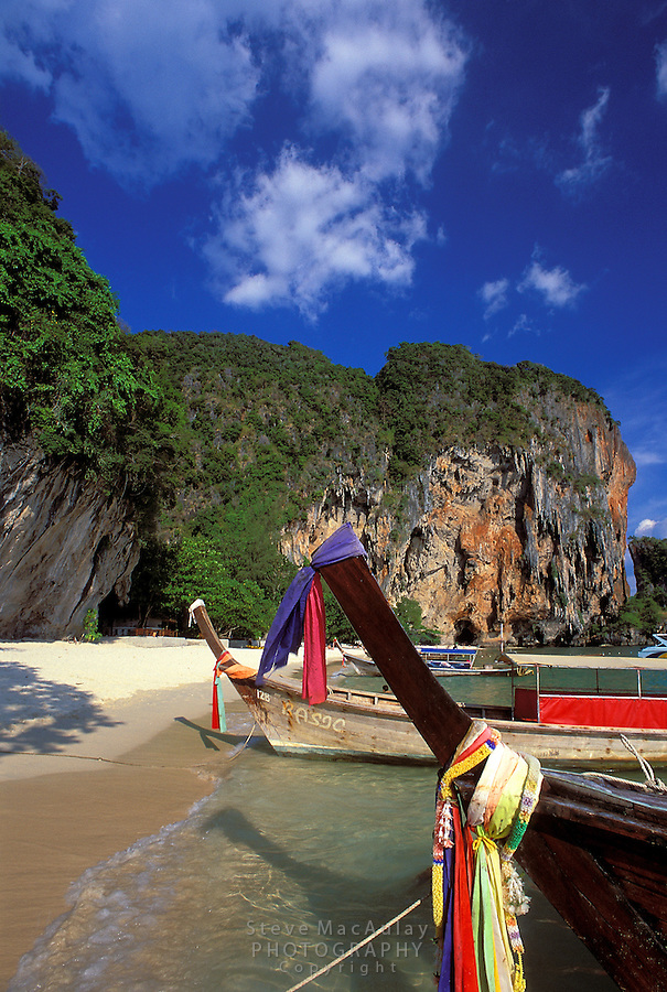 Longtail boats pulled up onshore at Phra Nang Beach, Railay Rei Lei, Thailand