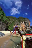 Longtail boats pulled up onshore at Phra Nang Beach, Railay Rei Lei, Thailand