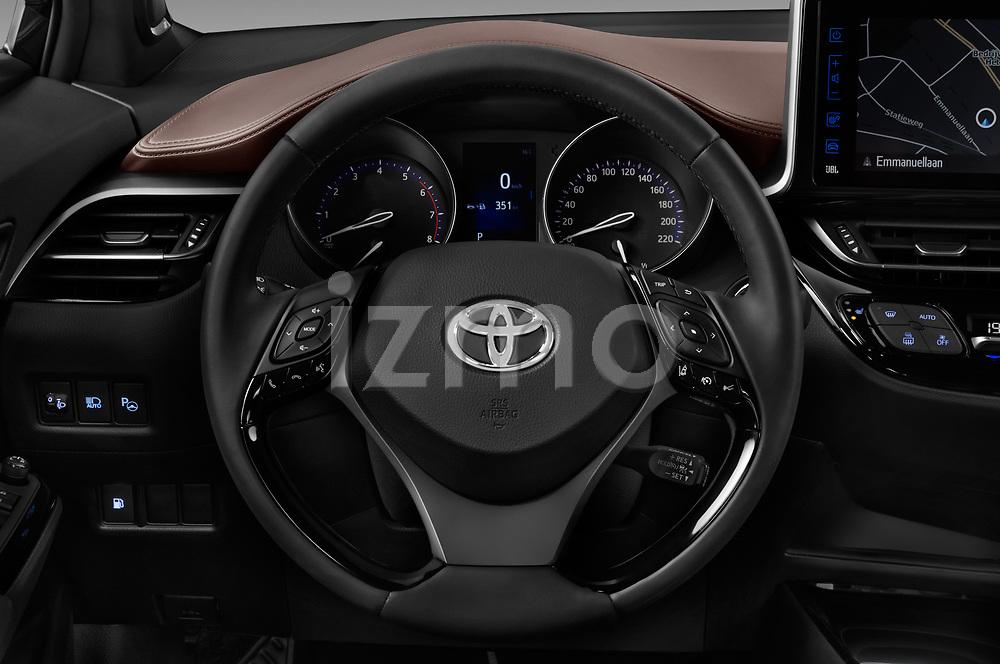 Car pictures of steering wheel view of a 2017 Toyota C-HR C-Show 5 Door SUV Steering Wheel