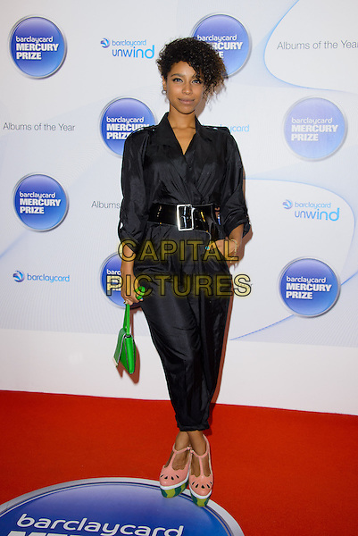 Lianne La Havas<br /> Barclaycard Mercury Prize Nominations at the Hospital, Endell Street.<br /> Where: London, England.<br /> 11th September 2013<br /> full length jumpsuit black hand in pocket black green handbag purse bag pink watermelon shoes melon <br /> CAP/CJ<br /> &copy;Chris Joseph/Capital Pictures