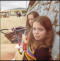 BNPS.co.uk (01202 558833)<br /> Pic:  LindyCarr/BNPS<br /> <br /> Lindy Carr, pictured on the left with actress Julie Dawn Cole, who played selfish Veruca Salt.  Pictured on a beach aged about 12.<br /> <br /> One of the five golden tickets used in the film Willy Wonka & The Chocolate Factory has sold for just over £16,000.<br /> <br /> The shiny slip of foil paper was the one English brat Veruca Salt 'found' after her wealthy father got his factory work-force to open thousands of Wonka chocolate bars.<br /> <br /> After filming had finished actress Julie Dawn Cole, who played selfish Veruca in the 1971 movie, kept hold of the 5ins by 7ins golden ticket.<br />  <br /> Julie later gifted it and a fake Wonka chocolate bar to her friend Lindy Sellers.