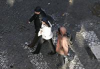 A african homeless reacts next tourist at downtown Lisbon on 8 Dezember, 2006.