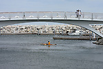 At the Milwaukee Lakefront on Lake Michigan visitors are enjoying the decorative bridge and kayaking in the lake