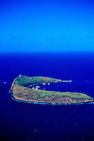 Aerial view of Molokini with boats moored off this partially exposed crater. Molokini has fantastic snorkeling and is a popular tourist destination off the southeastern end of Maui
