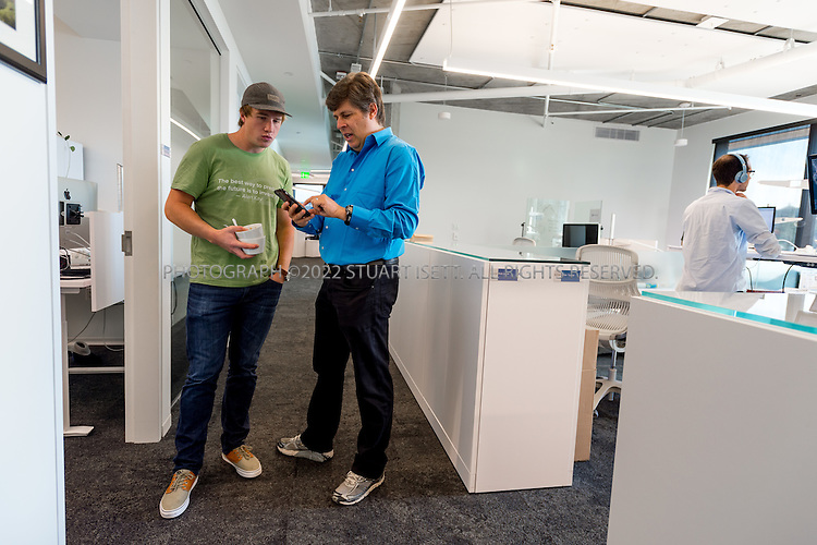 SEATTLE, USA - SEPTEMBER 16th, 2015<br /> <br /> Dr. Oren Etzioni (right), Chief Executive Officer of the Allen Institute for Artificial Intelligence, takes with Sam Skjonsberg (left), a Lead Front End Engineer at the institute&rsquo;s office in Seattle, WA, USA. <br /> <br /> The Allen Institute for Artificial Intelligence (abbreviated AI2) is a research institute funded by Microsoft co-founder Paul Allen to achieve scientific breakthroughs by constructing AI systems with reasoning, learning and reading capabilities. Oren Etzioni was appointed by Paul Allen in September 2013 to direct the research at the institute.<br /> <br /> (Photo by Stuart Isett for The Washington Post)
