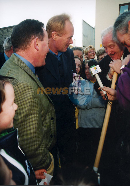 Les Battersby talking to some of the Locals that gathered at the opening of Eddies Hardware superstore in Scarlet stret to see les.Pic Fran Caffrey Newsfile
