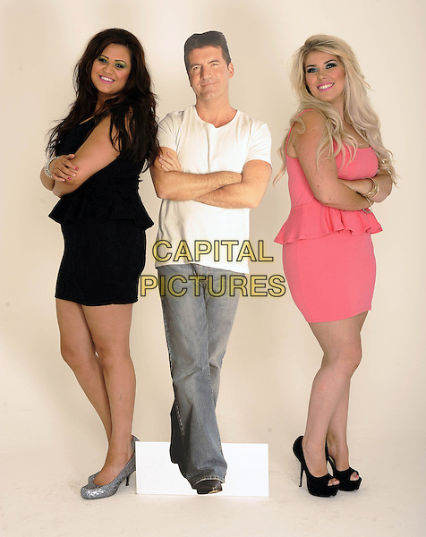 '2 Shoes' duo Lucy Texeira & Charley Bird, London, .August 30th, 2012.**Exclusive. Double fees apply.**.studio x factor full length black pink peplum dress Simon Cowell cardboard cutout jeans denim silver shoes arms crossed white t-shirt .CAP/FIN.©Steve Finn/Capital Pictures.