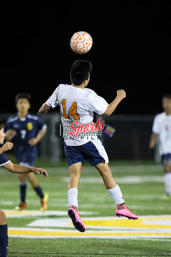 Brandon Flores (14) of the Carson Cougars heads the ball during first half action against the South Iredell Vikings at Central Cabarrus High School on November 10, 2015 in Concord, North Carolina.  The Cougars defeated the Vikings 6-0 in the second round of the 2015 NCSHAA 3A playoffs.  (Brian Westerholt/Sports On Film)