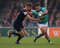 Newcastle Falcons' Sinoti Sinoti evades the tackle of Exeter Chiefs' Ollie Devoto<br /> <br /> Photographer Bob Bradford/CameraSport<br /> <br /> Gallagher Premiership - Exeter Chiefs v Newcastle Falcons - Saturday 23rd February 2019 - Sandy Park - Exeter<br /> <br /> World Copyright © 2019 CameraSport. All rights reserved. 43 Linden Ave. Countesthorpe. Leicester. England. LE8 5PG - Tel: +44 (0) 116 277 4147 - admin@camerasport.com - www.camerasport.com