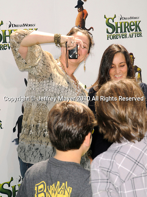 "UNIVERSAL CITY, CA. - May 16: Camryn Manheim, Milo Jacob (son) and guest arrive at the ""Shrek Forever After"" Los Angeles Premiere at Gibson Amphitheatre on May 16, 2010 in Universal City, California."