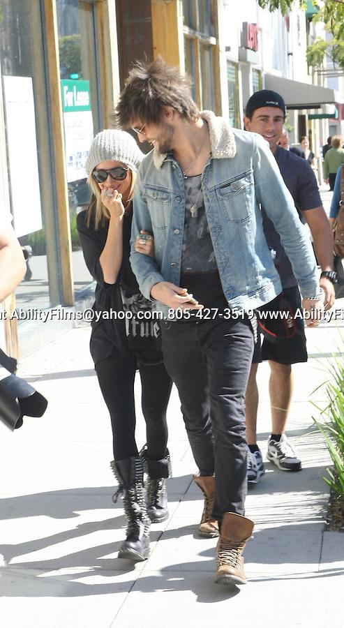 Feb 23rd 2012..Ashley Tisdale holding hands in Beverly Hills California with her boyfriend ..AbilityFilms@yahoo.com.805-427-3519.www.AbilityFilms.com...