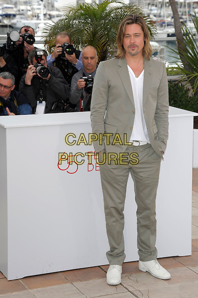 Brad Pitt .'Killing Them Softly' photocall at the 65th  Cannes Film Festival, France..22nd May 2012.full length goatee facial hair grey gray white suit top hands in pockets .CAP/PL.©Phil Loftus/Capital Pictures.