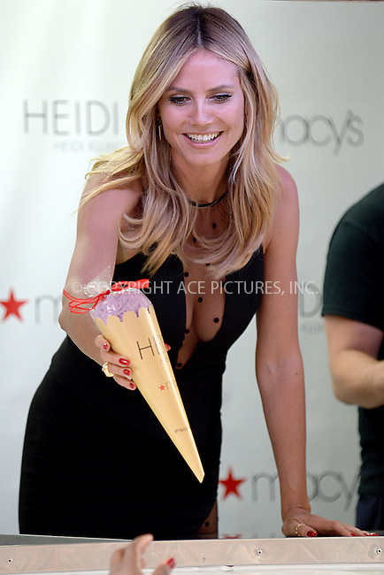 www.acepixs.com<br /> June 23, 2016 New York City<br /> <br /> Heidi Klum gives out ice cream cone shaped gift bags in Herald Square in New York City on June 23, 2016.<br /> <br /> Credit: Kristin Callahan/ACE Pictures<br /> <br /> tel: 646 769 0430<br /> Email: info@acepixs.com