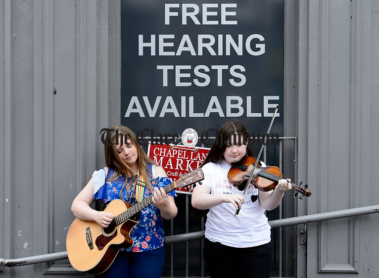 Jade Purcell and Niamh Conroy of Limerick performing on O Connell street during Fleadh Cheoil na hEireann in Ennis. Photograph by John Kelly.