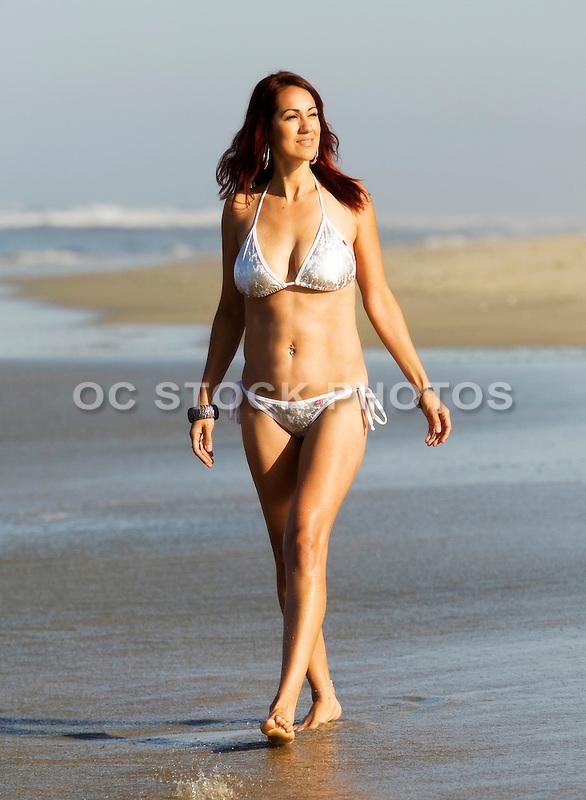 Sexy Bikini Model Walking on The Beach