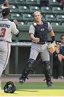 Catcher Shea Langeliers (4) of the Rome Braves, an Atlanta Braves' First-Round pick in the 2019 MLB Draft, tosses a ball to third baseman Darling Florentino (13) in a game against the Greenville Drive on Sunday, June 30, 2019, at Fluor Field at the West End in Greenville, South Carolina. Rome won, 6-3. (Tom Priddy/Four Seam Images)