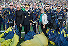 Sept. 6, 2014; University president Rev. John I. Jenkins, C.S.C. and Army Gen. Martin E. Dempsey, chairman of the Joint Chiefs of Staff, pose for a photo with paratroopers prior to the Michigan game. (Photo by Barbara Johnston/ University of Notre Dame)