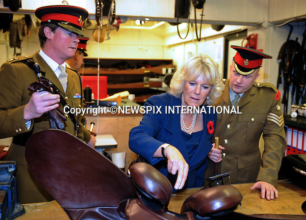 "CAMILLA, DUCHESS OF CORNWALL.visits The Household Cavalry Mounted Regiment (HCMR) at Hyde Park Barracks, Knightsbridge, London_4/11/2010.Photo Credit: ©D Harmer_Newspix International..**ALL FEES PAYABLE TO: ""NEWSPIX INTERNATIONAL""**..PHOTO CREDIT MANDATORY!!: NEWSPIX INTERNATIONAL..IMMEDIATE CONFIRMATION OF USAGE REQUIRED:.Newspix International, 31 Chinnery Hill, Bishop's Stortford, ENGLAND CM23 3PS.Tel:+441279 324672  ; Fax: +441279656877.Mobile:  0777568 1153.e-mail: info@newspixinternational.co.uk."
