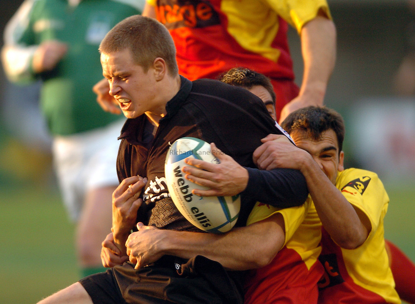 Photo. Henry Browne..Perpignan v Newcastle Falcons..Heineken Cup..08/01/2005..Mathew Tait gets tackled..