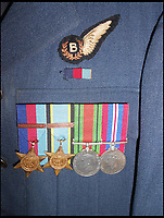 BNPS.co.uk (01202 558833)<br /> Pic: JoePinguey/BNPS.<br /> <br /> F/O Leslie Pulfrey's dress uniform and medals.<br /> <br /> The tragic tale of downed RAF Lancaster bomb aimer and the heartwarming friendship which developed between the farmer who found his body and his grieving family can be told after his medals emerged for sale.<br /> <br /> Flying Officer Leslie Pulfrey, of 103 Sqn RAF Bomber Command was killed when his Lancaster was shot down by a Luftwaffe fighter over the Netherlands on the way back from a raid on a German oil refinery.<br /> <br /> His body was found on 16th June 1944 by a Dutch farmer Gerrit Van Eerden wrapped in an unopened parachute and with bullet wounds to his neck.<br /> <br /> Only one of the crew survived the crash and Pulfrey was laid to rest with five of his comrades in the local cemetery.<br /> <br /> Fly Off Pulfrey's nephew Joe Pinguey, 67, a retired motor mechanic from Penistone, south Yorkshire, is putting his medals on the market with Sheffield Auction Gallery for &pound;1,200.