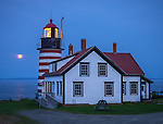 Lubec, Maine:<br /> West Quoddy Head Light at dusk with rising moon