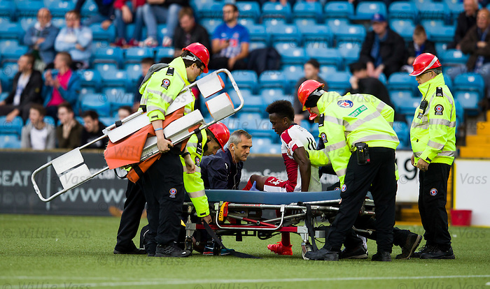 Joe Dodoo helped onto the stretcher by physio Stevie Walker