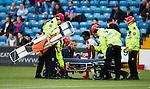 Joe Dodoo helped onto the stretcher by physio Stevie Walker