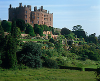 The medieval exterior of Powis Castle towers over its magnificent terraced gardens