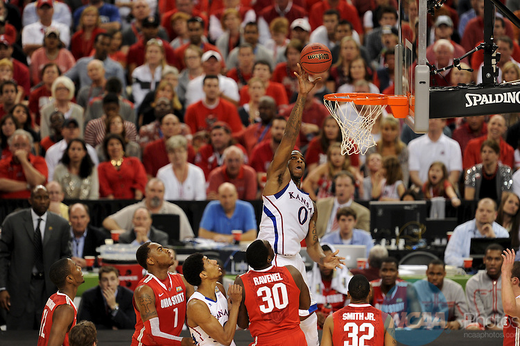 31 MAR 2012:  Thomas Robinson (0) of University of Kansas shoots over Evan Ravenel (30) of the Ohio State University during the Semifinal Game of the 2012 NCAA Men's Division I Basketball Championship Final Four held at the Mercedes-Benz Superdome hosted by Tulane University in New Orleans, LA. Kansas defeated Ohio State 64-62 to advance to the national final. Brett Wilhelm/ NCAA Photos