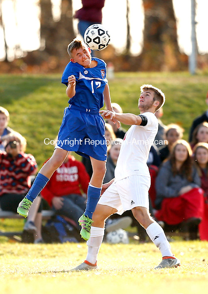 Litchfield, CT- 10 November 2016-111016CM06-  St Paul's Ethan Rembish goes up to head the ball against Wamogo's Ryan DeLello during their state tournament matchup on Thursday.     Christopher Massa Republican-American